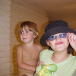 My 10th birthday, holding my naked sister...and why. Blue glasses, ugly hat, and red lip gloss are apparently a good combo.
