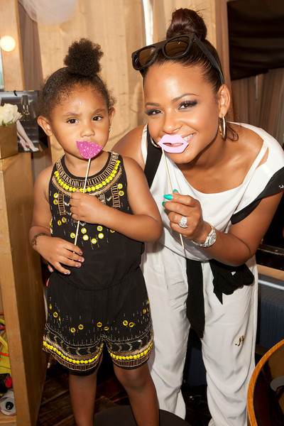 5th On The Go Mother's Day Beauty Event Christina Milian and Violet by Michael Bezjian