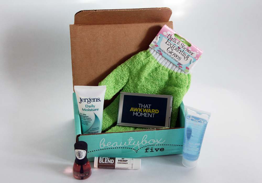 January 2014 Beauty Box 5 Review That Awkward Moment Movie Exfoliating Gloves Jergens Daily Moisture Lotion Epic Blend Hemp Coconut Chapstick Nubar Passionfruit Cuticle Oil H20+ Sea Lotus Body Wash
